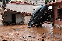 Pictured: Two cars piled up against a house wall.<br /> Re: Five people have reportedly died and severe damage caused by heavy rain and flash flooding in the area of Mandra, near Athens, Greece. Wednesday 15 November 2017