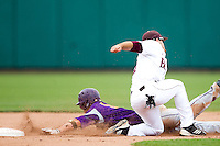 Joey Hawkins (7) of the Missouri State Bears tags out a base runner during a game against the Evansville Purple Aces at Hammons Field on May 12, 2012 in Springfield, Missouri. (David Welker/Four Seam Images)