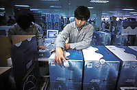 Workers assemble and package computers at a Lenovo Computer factory in Guangzhou, China. Lenovo Group (was formerly known as Legend) is China's largest maker of personal computer. Lenovo announced a definitive agreement under which Lenovo will acquire IBM's Personal Computing Division to form the world's third-largest PC business, bringing IBM's leading enterprise-class PC technologies to the consumer market and giving Lenovo global market reach beyond China and Asia..13-MAR-01