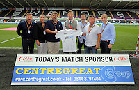 Match sponsors with Lee Trundle before the Premier League match between Swansea City and Manchester City at The Liberty Stadium in Swansea, Wales, UK. Saturday 24 September 2016