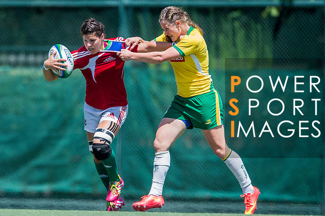 Portugal vs Brazil during the Day 2 of the IRB Women's Sevens Qualifier 2014 at the Skek Kip Mei Stadium on September 13, 2014 in Hong Kong, China. Photo by Aitor Alcalde / Power Sport Images