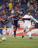 New England Revolution midfielder Shalrie Joseph (21) passes the ball as Chicago Fire midfielder Baggio Husidic (9) defends. The New England Revolution tied the Chicago Fire, 0-0, at Gillette Stadium on October 17, 2009.