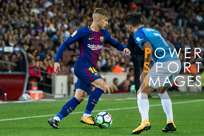 Gerard Deulofeu Lazaro of FC Barcelona is tackled by Juan Carlos Perez Lopez, Juankar, of Malaga CF during the La Liga 2017-18 match between FC Barcelona and Malaga CF at Camp Nou on 21 October 2017 in Barcelona, Spain. Photo by Vicens Gimenez / Power Sport Images