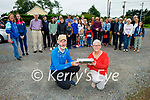 Members of the Lixnaw Development Association burying two time capsules on Sunday in Lixnaw, as part of National Heritage Week - one being reopened in 30 years, the other being reopened in 100 years. Kneeling front l to r: Dick McElligott (Chairman) and Maria Conway (Secretary).
