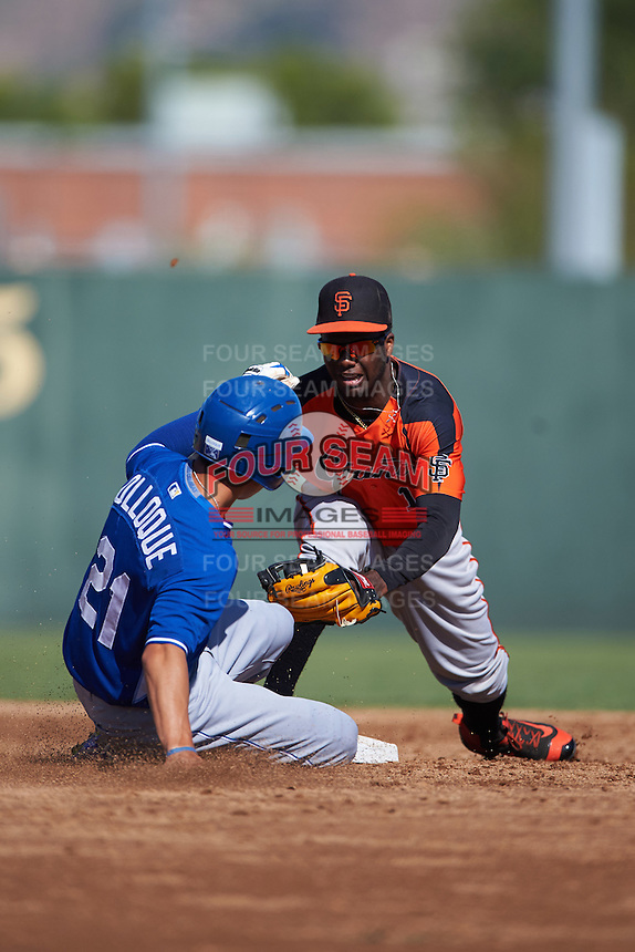 San Francisco Giants Kelvin Beltre (14) attempts to tag Manny Olloque (21) sliding into second during an instructional league game against the Kansas City Royals on October 23, 2015 at the Papago Baseball Facility in Phoenix, Arizona.  (Mike Janes/Four Seam Images)