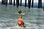 An Oceanside Lifeguard checks on the wellbeing of a Surfer.