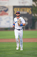 Ogden Raptors right fielder Matt Cogen (49) jogs off the field between innings of a Pioneer League game against the Great Falls Voyagers at Lindquist Field on August 23, 2018 in Ogden, Utah. The Ogden Raptors defeated the Great Falls Voyagers by a score of 8-7. (Zachary Lucy/Four Seam Images)