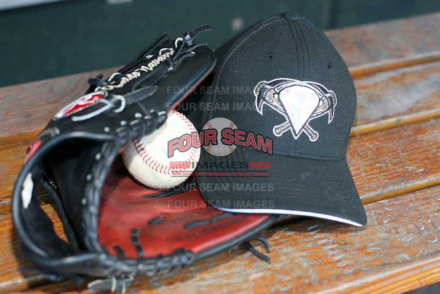 April 17, 2009: Hat of the West Tenn Diamond Jaxx, Southern League Class-AA affiliate of the Seattle Mariners, lays in a Rawlings glove with a ball before a game at the Baseball Grounds of Jacksonville in Jacksonville, FL.  Photo by:  Mike Janes/Four Seam Images