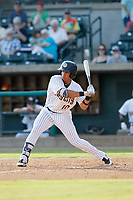 """Charleston Riverdogs infielder Oswaldo Cabrera (10) at bat during a game against the Hickory Crawdads at the Joseph P. Riley Ballpark in Charleston, South Carolina. For Sunday games, the Riverdogs wear their """"Holy City"""" uniforms in honor of the city's nickname. Hickory defeated Charleston 8-7. (Robert Gurganus/Four Seam Images)"""