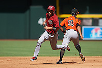 Arizona Diamondbacks Jason Morozowski (7) runs the bases past infielder Hector Santiago (10) during an instructional league game against the San Francisco Giants on October 16, 2015 at the Chase Field in Phoenix, Arizona.  (Mike Janes/Four Seam Images)