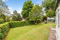 BNPS.co.uk (01202 558833)<br /> Pic: Homesestateagency/BNPS<br /> <br /> Pictured: The lawn in the garden.<br /> <br /> A timewarp home that has been lived in by the same family for more than a century has gone on sale for the first time since being built.<br /> <br /> At the time the property was built, King Edward VII was on the throne and the First World War had not even started.<br /> <br /> The property is being sold for £550,000 under probate by the original builder's three grandchildren, who were born in the Victorian-style house.<br /> <br /> The two-bedroomed home is in the Surrey town of Haslemere and belonged to the Berry family, who decided to sell after the death of their parents, Freda and Leslie.