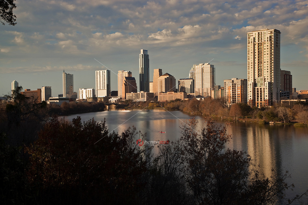 Another beautiful day in paradise on Lake Austin with the downtown skyline as a Kayaker navigates Lady Bird Lake