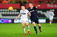 Daniel James of Swansea City vies for possession with Shane Ferguson of Millwall during the Sky Bet Championship match between Swansea City and Millwall at the Liberty Stadium in Swansea, Wales, UK. Saturday 09 February 2019