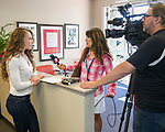 Salome Manska, left is interviewed by a local tv station during the Nevada Women's Fund Scholarship distribution, June 20, 2019.