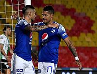 BOGOTA - COLOMBIA, 31-10-2020: Cristian Arango de Millonarios F. C. celebra con Ayron del Valle despues de anotar el tercer gol de su equipo, durante partido entre Millonarios F. C. y Atletico Nacional de la fecha 17 por la Liga BetPlay DIMAYOR 2020 jugado en el estadio Nemesio Camacho El Campin de la ciudad de Bogota. / Cristian Arango of Millonarios F. C. celebrates with Ayron del Valle after scoring the third goal of his team, during a match between Millonarios F. C. and Atletico Nacional of the 17th date for the BetPlay DIMAYOR League 2020 played at the Nemesio Camacho El Campin Stadium in Bogota city. / Photo: VizzorImage / Luis Ramirez / Staff.