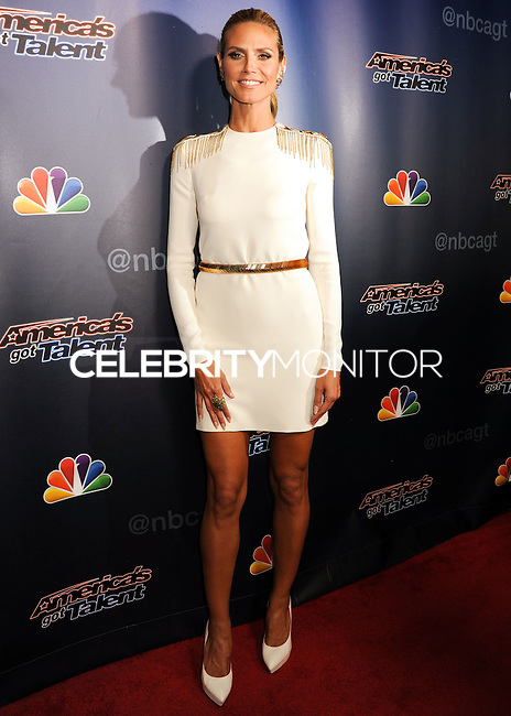 NEW YORK CITY, NY, USA - SEPTEMBER 03: Model Heidi Klum arrives at the 'America's Got Talent' Post-Show Red Carpet held at Radio City Music Hall on September 3, 2014 in New York City, New York, United States. (Photo by Celebrity Monitor)