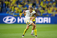LE HAVRE, FRANCE - JUNE 20: Tobin Heath #17, Jonna Andersson #2 during a 2019 FIFA Women's World Cup France group F match between the United States and Sweden at Stade Océane on June 20, 2019 in Le Havre, France.