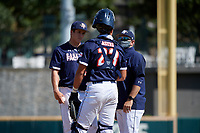 Pitcher Mason Marriott (14) and catcher Rene Lastres (23) talk with the pitching coach during the Baseball Factory All-Star Classic at Dr. Pepper Ballpark on October 4, 2020 in Frisco, Texas.  Pitcher Mason Marriott (14), a resident of Tomball, Texas, attends Tomball High School.  (Mike Augustin/Four Seam Images)