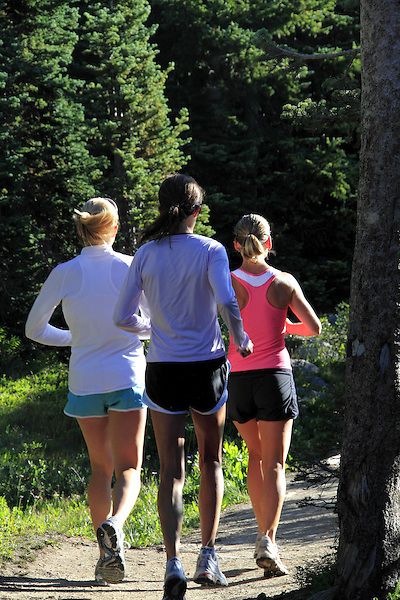 Women running west of Boulder, Colorado. .  John leads private photo tours in Boulder and throughout Colorado. Year-round.