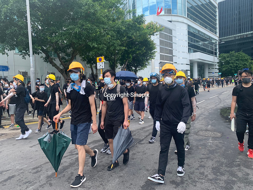 Demonstrators on the streets of Hong Kong 01 July 2019.. Mostly student and youth demonstrators break into the Hong Kong's Legislative Council Chamber 1st July 2019. The umbrella is seen as the symbol of the movement. The protestors caused widespread damage and are demonstrating against the extradition bill, since suspended, that was being pushed through the Hong Kong Council.