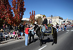 A rider with the 1st Nevada Cavalry greets the crowd during the 75th annual Nevada Day parade in Carson City, Nev., on Saturday, Oct. 26, 2013.<br /> Photo by Cathleen Allison