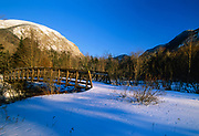 Scenic view from a bridge along the Franconia Notch Bike Path in Franconia Notch, New Hampshire during the winter months. Cannon Mountain is in the background.