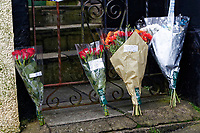Pictured: Flowers left outside the house where the killing happened in Aberdare. Tuesday 19 December 2017<br /> Re: Natasha Jex (also known as Natasha Smith) has killed her husband Neil Jex (also known as Neal Jex) at their house in Aberdare, Wales, UK.
