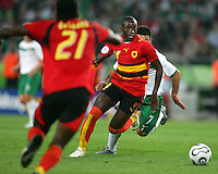 Mendonca (14) of Angola moves the ball towards Delgado (21). Mexico and Angola played to a 0-0 tie in their FIFA World Cup Group D match at FIFA World Cup Stadium, Hanover, Germany, June 16, 2006.