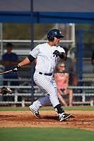 New York Yankees Eduardo Navas (10) follows through on a swing during an Instructional League game against the Baltimore Orioles on September 23, 2017 at the Yankees Minor League Complex in Tampa, Florida.  (Mike Janes/Four Seam Images)