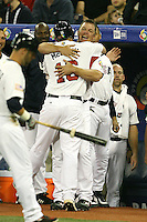 March 7, 2009:  Catcher Brian McCann (16) of Team USA hugged by Chipper Jones during the first round of the World Baseball Classic at the Rogers Centre in Toronto, Ontario, Canada.  Team USA defeated Canada 6-5 in both teams opening game of the tournament.  Photo by:  Mike Janes/Four Seam Images
