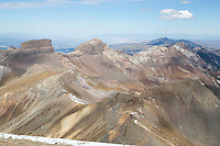 """Coxcomb and Redcliff from the summit of Wetterhorn.  Courthouse Mountain of """"True Grit"""" fame is visible in the distance just to the right of Redcliff."""