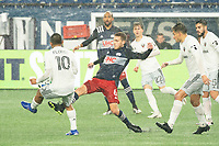 FOXBOROUGH, MA - NOVEMBER 1: Scott Caldwell #6 of New England Revolution comes in to tackle Edison Flores #10 of DC United during a game between D.C. United and New England Revolution at Gillette Stadium on November 1, 2020 in Foxborough, Massachusetts.