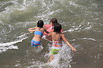 Girls playing Boulder Creek, Boulder, Colorado. .  John offers private photo tours in Denver, Boulder and throughout Colorado. Year-round.