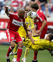 Columbus Crew foward Alejandro Moreno's (10) bicycle kick is blocked by Chicago Fire defender Brandon Prideaux (6) as C.J. Brown (2) looks on.  Moreno was called for a high kick on the play.  The Columbus Crew tied the Chicago Fire 2-2 at Toyota Park in Bridgeview, IL on September 20, 2009.