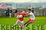 Daingean Uí Chúis Conchubar Ó Géibheannaigh tackled by An Ghaeltacht Peter Paul Sauerland during the West Kerry Championship Final at Pairc an Aghasaigh, Dingle, on Sunday afternoon.