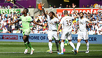 Kelechi Iheanacho of Manchester City celebrates scoring his goal to make the score 0-1 as Swansea players appeal for offside during the Barclays Premier League match between Swansea City and Manchester City played at The Liberty Stadium, Swansea on 15th May 2016