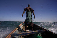 Out with canoe fishermen.  Guy in the prow of the boat (many photographs) is:  Modou Ngom  address: MBour Serere Kaw Senegal   Can call him on his friends cell phone: +221 957 1746..Boat full of net fishermen contact is:.Abdou Sarr +221 957 6252.Fishermen coming in and out of port at MBour, Senegal.  Everyone we talked to said the fishing was very poor compared to other years and that they were getting very few fish...There are more net fishermen in this area.  MBour is second only to Dakar in growth.  It is on trade routes from various countries and the fishing is good...600,000 Senegalese participate in the fishing industry.  When you multiply that number times the 6 or 7 kids they each have and other dependents, you can see that this is a significant percentage of the 12 million Senegalese.  Eighty percent of the fish caught are caught by artesinal fishermen.