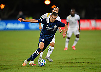 LAKE BUENA VISTA, FL - AUGUST 01: James Sands #16 of New York City FC dribbles away from pressure during a game between Portland Timbers and New York City FC at ESPN Wide World of Sports on August 01, 2020 in Lake Buena Vista, Florida.