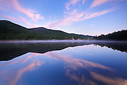 Crawford Notch State Park - Reflection of mountain range and Crawford Depot in Saco Lake during the summer months in the White Mountains, New Hampshire at sunrise.