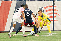 FOXBOROUGH, MA - SEPTEMBER 04: Joe Rice #51 of New England Revolution II retrieves the ball as Maciel #6 of New England Revolution II blocks Paulo Junior #11 Forward Madison FC from advancing further during a game between Forward Madison FC and New England Revolution II at Gillette Stadium on September 04, 2020 in Foxborough, Massachusetts.