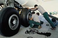 - maintenance of landing gear wheels of a Boeing 747 Alitalia aircraft in the airport of Milan Malpensa....- manutenzione ruote del carrello di un aereo Boeing 747 Alitalia all'aeroporto di Milano Malpensa