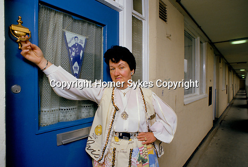 'ELVIS FANS', VALERIE CONSTABLE STANDING AT THE FRONT DOOR OF HER SOUTH LONDON FLAT WHICH HAS A 'GRACELANDS' KNOCKER, THE NAME OF ELVIS'S HOME IN MEMPHIS.