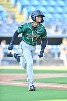 Greensboro Grasshoppers Liover Peguero (10) runs to first base during a game against the Asheville Tourists on August 24, 2021 at McCormick Field in Asheville, NC. (Tony Farlow/Four Seam Images)