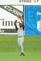 Wilson Tobs left fielder Kevin Jordan #21 (Wake Forest) settles under a fly ball against the High Point-Thomasville HiToms at Finch Field on June 17, 2013 in Thomasville, North Carolina.  The Tobs defeated the HiToms 3-2 in 11 innings.  Brian Westerholt/Four Seam Images