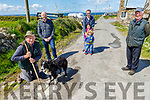 Residents of Clashmealcon in Causeway stand by the potholes and are annoyed at the state of their road on Friday. <br /> Front right: Thomas Harrington and his dog Aero. <br /> Back l to r: Patrick Doyle, JJ, Eoin and Maria Walsh and Michael Dineen.