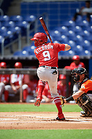 Washington Nationals Carter Kieboom (9) at bat in front of catcher Nick Fortes (12) during a Florida Instructional League game against the Miami Marlins on September 26, 2018 at the Marlins Park in Miami, Florida.  (Mike Janes/Four Seam Images)