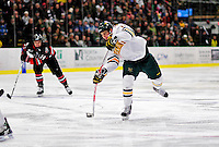 26 November 2010: University of Vermont Catamount forward Matt Marshall, a Junior from Hingham, MA, takes a shot against the Northeastern University Huskies at Gutterson Fieldhouse in Burlington, Vermont. The Huskies came back from a 2-0 deficit to earn a 2-2 tie against the Catamounts. Mandatory Credit: Ed Wolfstein Photo