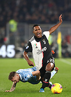 Football, Serie A: S.S. Lazio - Juventus Olympic stadium, Rome, December 7, 2019. <br /> Juventus' Alex Sandro (r) in action with Lazio's Manuel Lazzari (l) during the Italian Serie A football match between S.S. Lazio and Juventus at Rome's Olympic stadium, Rome on December 7, 2019.<br /> UPDATE IMAGES PRESS/Isabella Bonotto