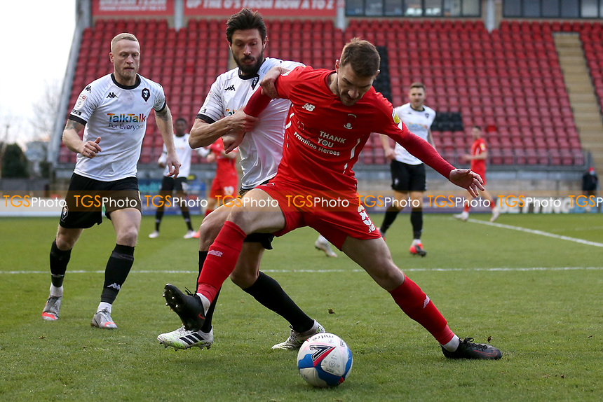 Craig Clay of Leyton Orient and Jason Lowe of Salford City during Leyton Orient vs Salford City, Sky Bet EFL League 2 Football at The Breyer Group Stadium on 2nd January 2021
