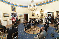 President Donald J. Trump delivers remarks at a Presidential Recognition Ceremony celebrating volunteers during the coronavirus pandemic and their hard work, heroism, and hope Friday, May 1, 2020, in the Blue Room of the White House<br /> <br /> People:  President Donald Trump